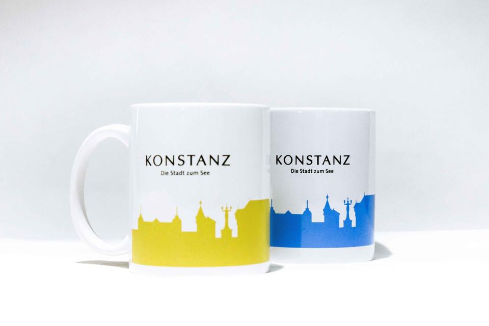 Konstanz-Merchandise-Tasse-gelb-blau_Copyright_MTK-Franziska-Heinz